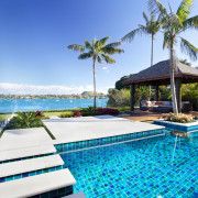 Tropical outdoor area with pergola, sandstone paving and arecales, caribbean, estate, leisure, palm tree, property, real estate, resort, resort town, sea, sky, swimming pool, tropics, vacation, villa, water, teal, white