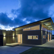 Lockwood show home Tauranga - A high raking architecture, building, cloud, daylighting, estate, facade, home, house, lighting, property, real estate, residential area, roof, sky, blue, black