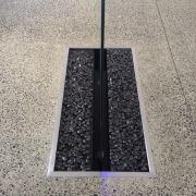 Waterworks indoor water feature.  A shimmering sheet floor, gray