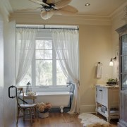 Furniture pieces define this master bathroom, enhancing its bedroom, ceiling, curtain, daylighting, decor, floor, home, house, interior design, living room, molding, real estate, room, shade, textile, wall, window, window blind, window covering, window treatment, wood, gray, brown