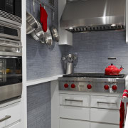 Reflective gray-blue glass mosaics line the walls of cabinetry, countertop, home appliance, interior design, kitchen, kitchen appliance, kitchen stove, major appliance, room, gray