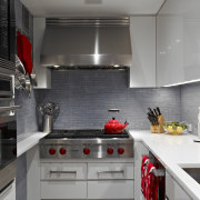 A narrow shelf next to the cooktop is countertop, interior design, kitchen, room, gray, black