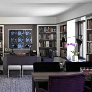 The darker den area in this remodeled apartment bookcase, furniture, home, interior design, living room, purple, room, shelving, black, gray