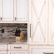 Whitewashed wood cabinetry, granite countertops and a mosaic chest of drawers, drawer, floor, furniture, wood, wood stain, white