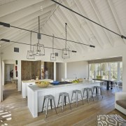 The kitchen in this country house is positioned ceiling, daylighting, interior design, real estate, roof, gray