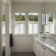 Simple white cabinetry is a feature of this door, home, interior design, property, real estate, room, window, gray