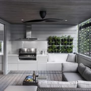 Open-plan family kitchen outdoor area. Perimeter cabinetry in architecture, home, house, interior design, living room, gray, black