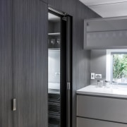 Seamless door and cabinetry ensures a clean aesthetic home appliance, interior design, gray, black