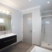 the ensuite and the family bathroom offer easy0clean bathroom, home, interior design, property, real estate, room, gray
