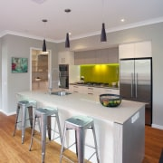Modern family kitchen features bamboo floor.  negative countertop, floor, furniture, interior design, kitchen, real estate, room, table, gray