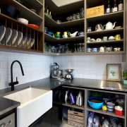 This butlers pantry links with the kitchen in countertop, interior design, kitchen, room, black, white