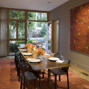 This formal dining room adjoins the kitchen. Like dining room, home, interior design, living room, room, table, window, brown