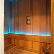 A cedar-lined sauna room, with LED lighting is interior design, lighting, sauna, wood, wood stain, brown