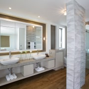 Textural tiles reference rippling waves were specified for bathroom, estate, home, interior design, real estate, room, sink, gray