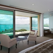 Large sliding doors open up this master suite estate, house, interior design, penthouse apartment, property, real estate, room, window, gray