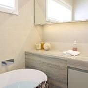 This guest bathroom was transformed by designer Celia bathroom, bathroom accessory, countertop, floor, home, interior design, plumbing fixture, room, sink, tap, tile, wall, white