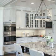The traditional cabinetry has a custom finish created cabinetry, countertop, cuisine classique, floor, interior design, kitchen, room, table, gray