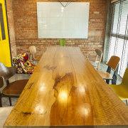 Warner Music - Vibrant hip workplace - Warner interior design, real estate, room, table, wood, orange, brown