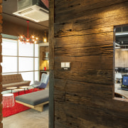 Emphasis on recycled materials seen in reused railway home, interior design, loft, wall, wood, brown