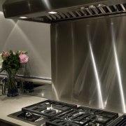 Sleek, contemporary German kitchen - Sleek, contemporary German countertop, home appliance, kitchen, kitchen appliance, kitchen stove, black, gray