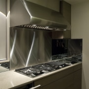 Sleek, contemporary German kitchen - Sleek, contemporary German cabinetry, countertop, home appliance, interior design, kitchen, kitchen stove, major appliance, room, under cabinet lighting, brown