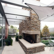 A wall of natural stone has a 