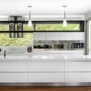 Sleek contemporary kitchen with Smeg appliances - Sleek countertop, interior design, kitchen, white