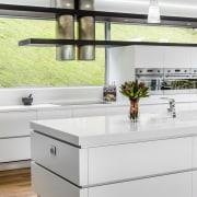 Sleek contemporary kitchen with Smeg appliances - Sleek countertop, furniture, interior design, kitchen, product design, table, white