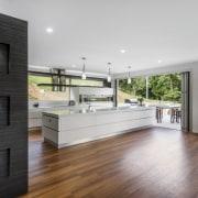 Sleek contemporary kitchen with Smeg appliances - Sleek architecture, floor, flooring, hardwood, interior design, kitchen, laminate flooring, real estate, wood flooring, gray