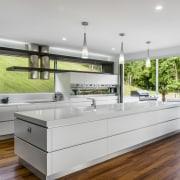 Sleek contemporary kitchen with Smeg appliances - Sleek countertop, interior design, kitchen, real estate, gray