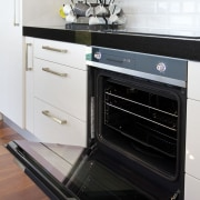The highly reflective quadruple glazed oven door opens countertop, gas stove, home appliance, kitchen, kitchen appliance, kitchen stove, major appliance, oven, small appliance, white, black