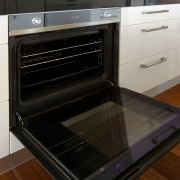 Contemporary kitchen with Smeg appliances - Contemporary kitchen countertop, gas stove, home appliance, kitchen, kitchen appliance, kitchen stove, major appliance, microwave oven, oven, black