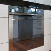 The highly reflective quadruple glazed oven door opens countertop, home appliance, kitchen, kitchen appliance, kitchen stove, major appliance, product, product design, gray, white