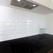 Induction cooktops are the fastest growing sector of architecture, ceiling, countertop, daylighting, floor, flooring, glass, interior design, kitchen, product design, sink, tile, white, black