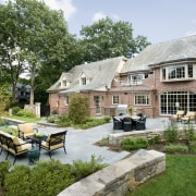 An extensive remodeling project has transformed this 1920s backyard, cottage, courtyard, estate, farmhouse, garden, home, house, landscape, landscaping, outdoor structure, property, real estate, yard