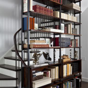Stair in Manhattan townhouse remodel - Stair in bookcase, furniture, library, library science, public library, shelf, shelving, gray, black