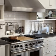Designed for the serious cook, this kitchen features cabinetry, countertop, cuisine classique, home appliance, interior design, kitchen, kitchen appliance, kitchen stove, gray