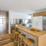 This high-end timber and steel kitchen was manufactured house, interior design, kitchen, real estate, wood flooring, gray