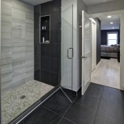 With glittering reflections, dancing flames and smooth textures, bathroom, floor, flooring, interior design, room, tile, gray, black