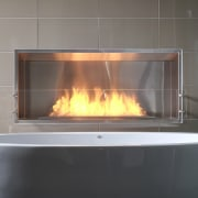With glittering reflections, dancing flames and smooth textures, fireplace, hearth, heat, wood burning stove, gray