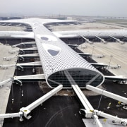 Looking much like a giant sculpture from both aerospace engineering, air travel, aircraft, airline, airplane, airport, airport apron, airport terminal, aviation, flap, runway, wing, gray