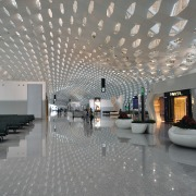 Looking much like a giant sculpture from both airport terminal, architecture, ceiling, daylighting, interior design, lobby, gray