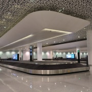 The check-in islands, gates and passport-check area all airport terminal, architecture, building, daylighting, infrastructure, interior design, lobby, structure, gray