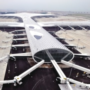 Looking much like a giant sculpture from both aerospace engineering, air travel, aircraft, airline, airplane, airport, airport apron, airport terminal, aviation, bird's eye view, flap, runway, wing, gray