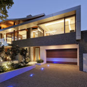 A front facade of glass, Balinese stone and architecture, building, elevation, estate, facade, home, house, interior design, landscape lighting, lighting, property, real estate, residential area, roof, villa, window, black
