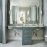 This remodeled bathroom incorporates a reflective wall of bathroom, bathroom accessory, bathroom cabinet, home, interior design, room, sink, gray