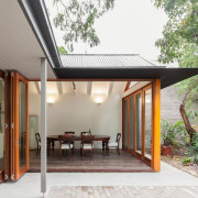 The thin-edged steel awning around this open-plan dining architecture, courtyard, home, house, property, real estate, roof, gray