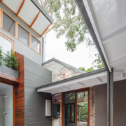 Here, a brick facade of the original dwelling architecture, courtyard, daylighting, estate, facade, home, house, real estate, residential area, roof, siding, window, gray, white