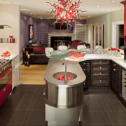the red range is balanced by a red cabinetry, countertop, cuisine classique, interior design, kitchen, room, brown, orange