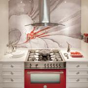 A bright red Bertazzoni range is a colourful countertop, home appliance, interior design, kitchen, kitchen appliance, kitchen stove, room, wall, gray